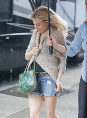 Sienna Miller headed out in New York City wearing a cute beige cardigan with braided trim.