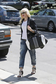 Gwen Stefani kept the monochrome theme going with a stylish studded tote.