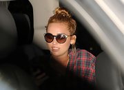 Miley Cyrus geared up for Miami's sunny weather with a pair of round sunglasses.