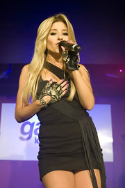 Mollie King teamed fingerless snakeskin gloves with a sexy LBD for a performance at Galaxy Radio's first birthday party.