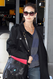 Camilla Belle hid her eyes behind a pair of cateye sunnies as she made her way through JFK.
