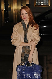 Jessica Chastain teamed a patterned scarf with a beige wool coat for a night out in New York City.