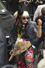 Lady Gaga headed to 'Letterman' wearing a black mantilla by Christian Lacroix Couture.