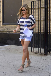 Jennifer Aniston topped off her shorts with a blue and white striped T-shirt.
