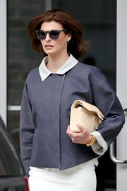 Linda Evangelista headed to family court wearing a white dress topped with a loose suede jacket.