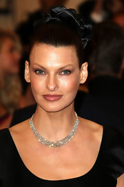 Linda Evangelista looked elegant wearing a black satin dress and an expensive-looking diamond necklace.