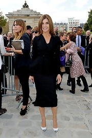 Carine Roitfeld cut a feminine silhouette in a black fit-and-flare jacket teamed with a pencil skirt during the Dior fashion show.