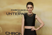 Lily Collins attended the Berlin premiere of 'The Mortal Instruments: City of Bones' wearing a luxurious coiled gold watch by Movado.