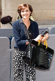 Ines de la Fressange carried an oversized patent tote at the Christian Dior show.