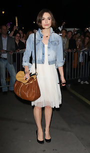 Keira Knightley left the Comedy Theater carrying a stylish two-tone leather hobo bag by Miu Miu.