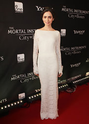 Lily Collins looked almost bridal in a white lace gown by Houghton at the Toronto premiere of 'The Mortal Instruments: City of Bones'.