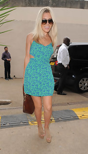 Mollie King added inches with a pair of sky-high platform sandals by Carvela.