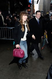 Jessica Biel left the 'Good Morning America' studio carrying a Louis Vuitton Speedy bag in a vibrant raspberry hue.