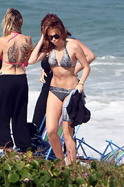 Miley Cyrus showed off her beach body in a gray halter bikini during a trip to Rio.