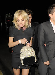 Pixie Lott looked like a schoolgirl with this backpack and collared dress combo while out clubbing.