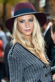 Poppy Delevingne arrived for the Chanel fashion show wearing a color-block walker hat.