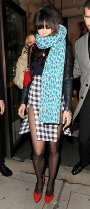 Daisy Lowe bundled up in a patterned blue scarf.
