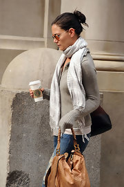 For added warmth, Katie Holmes wore a gray scarf that featured a tonal plaid print.