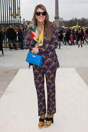 Anna dello Russo went for a retro vibe in a Miu Miu printed pantsuit during the Valentino fashion show.