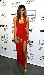 Chanel Iman completed her gold and red-themed look with a snakeskin clutch.