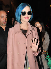 Katy Perry sported a fab pair of glitter shades by Miu Miu while out and about in Paris.