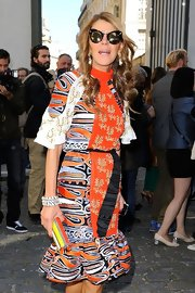 Anna dello Russo finished off her ensemble with layers of zebra bangles that she designed for H&M.