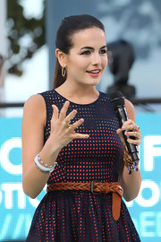 Camilla Belle hosted the Cotton 24 runway show wearing a cute lattice dress styled with a woven leather belt.
