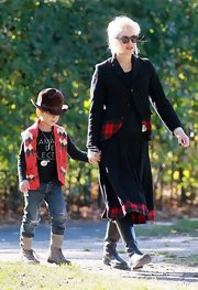 Gwen Stefani enjoyed a day at the park wearing a tartan-hem skirt suit.