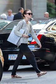 Emma Watson was dressed down in a Barneys New York striped scoopneck sweater while out and about in NYC.