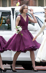 Keira Knightley looked pretty in her purple bridesmaid dress during her brother's wedding.