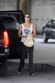 Padma Lakshmi was spotted out in New York City carrying a cream-colored ostrich-leather bucket bag.