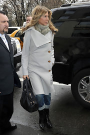Jennifer Aniston teamed black Azzedine Alaia combat boots with a gray coat for a cold day out in New York City.