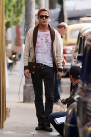 Ryan Gosling looked adorable while clad in a cream reindeer cardigan on the set of 'Gangster Squad.'