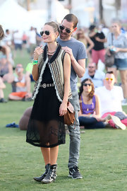 Kate Bosworth went for boho charm at Coachella in a patterned vest layered over a sheer LBD, both by Topshop.