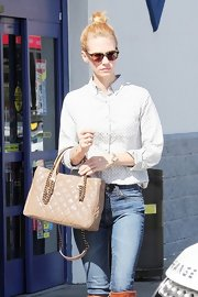 January Jones kept the sun out with a pair of round shades while running errands.