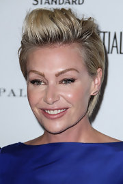 Portia de Rossi rocked a sky-high fauxhawk at the Los Angeles Confidential May/June issue celebration.