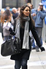 Katie Holmes wore a pair of winter gloves for added warmth.