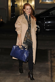 Jessica Chastain added an elegant pop with a blue Balenciaga crocodile tote.