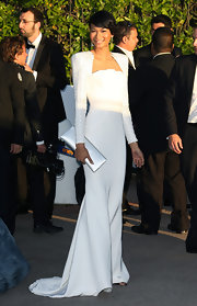 Chanel Iman polished off her all-white look with an elegant satin clutch.