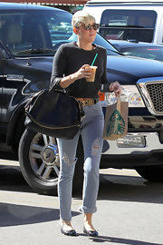 Miley Cyrus went rugged in ripped, faded jeans teamed with a cropped sweater for a day out in LA.