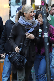 Jennifer Aniston accessorized with a textured black leather tote while filming 'Wanderlust.'