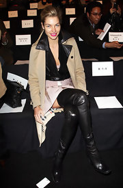 Jessica Hart worked it in black thigh-high boots and a tan trenchcoat during the Herve Leger fashion show.