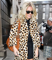Mollie King kept it classic with a pair of Ray-Ban wayfarers while visiting a London radio station.