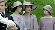 Michelle Dockery matched her co-stars in a vintage-chic lavender hat while filming 'Downton Abbey.'