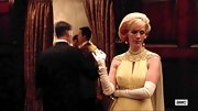 January Jones looked diva-glam wearing white opera gloves and a caped dress on 'Mad Men.'